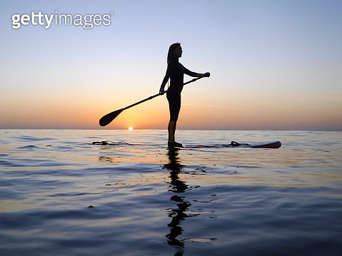 Girl practicing SUP