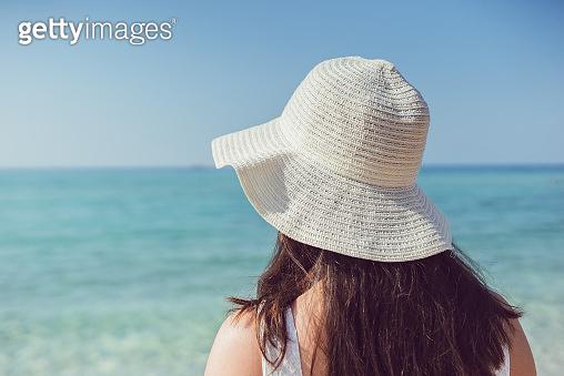 Elegant girl on the beach