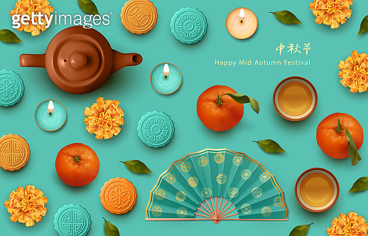 Teapot, tea cups, tangerines and moon cakes
