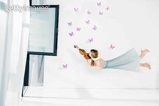 Woman levitating in air 3