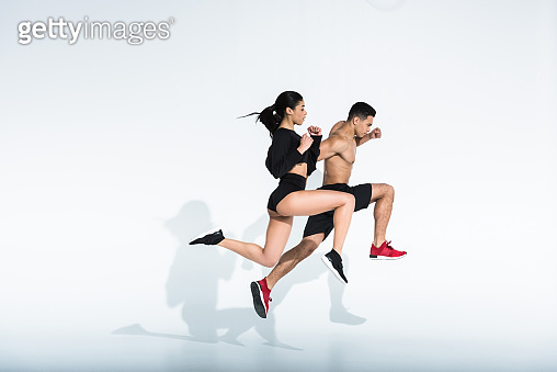 Sportive multicultural woman and man