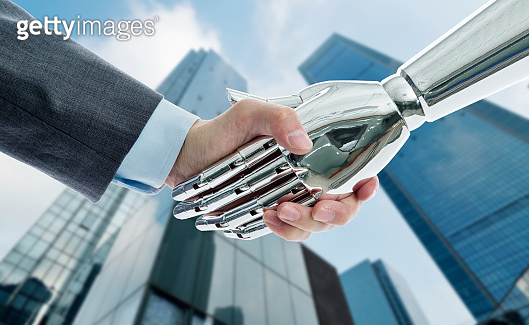 Man shaking hand with robot