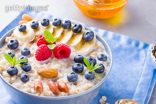 Healthy homemade oatmeal with berries and nuts for breakfast