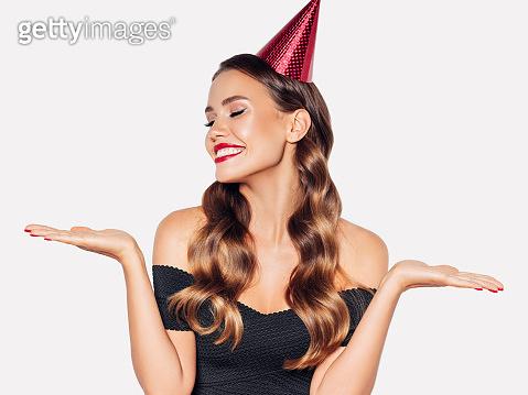 Beautiful woman in birthday cap