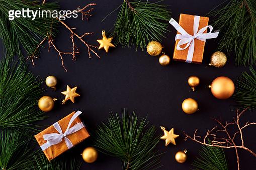 Gold christmas balls on a dark background