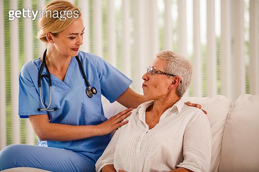 Patient talking to a smiling nurse