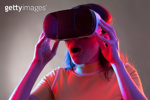 Young girl with VR goggles