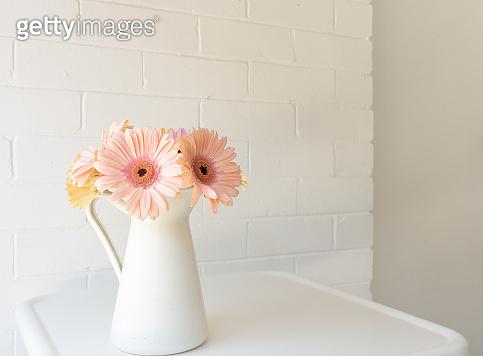 Flower in glass vase on table