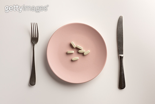 Capsule on a plate