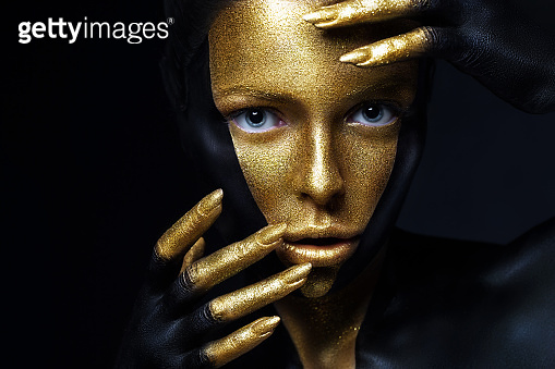 Creative make-up with black and gold leather