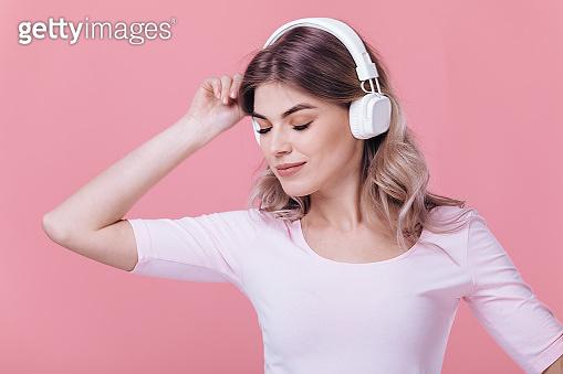 Woman in white headphones