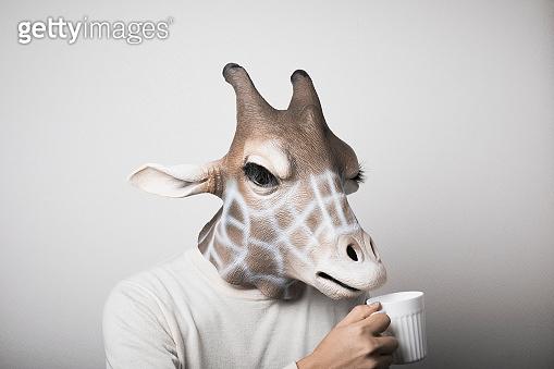 Portrait of man with giraffe mask