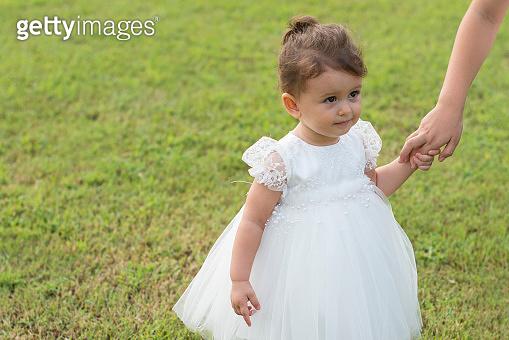 Toddler girl in a white dress