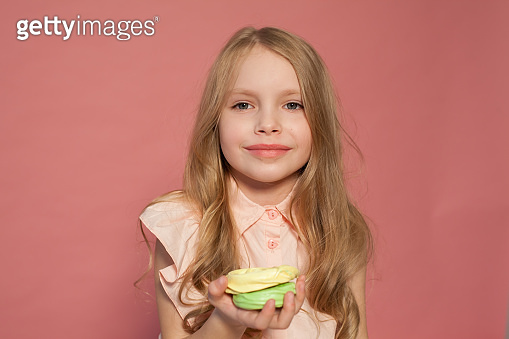 Small girl holds a sweet candy