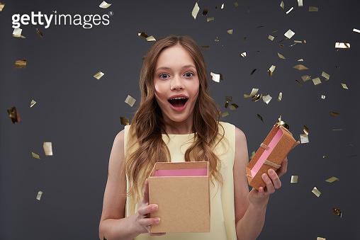 Holding opened gift box