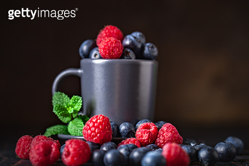 Raspberries and blueberries in a Cup