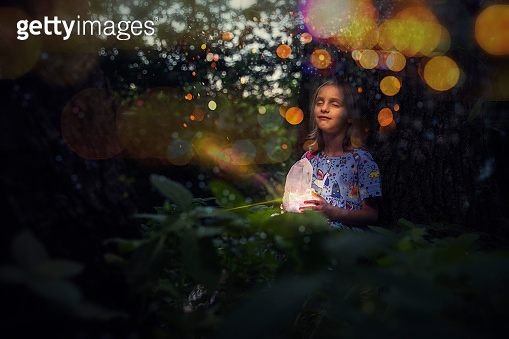 Little girl holding glowing crystal