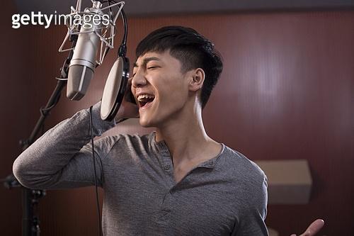 Singing in recording studio