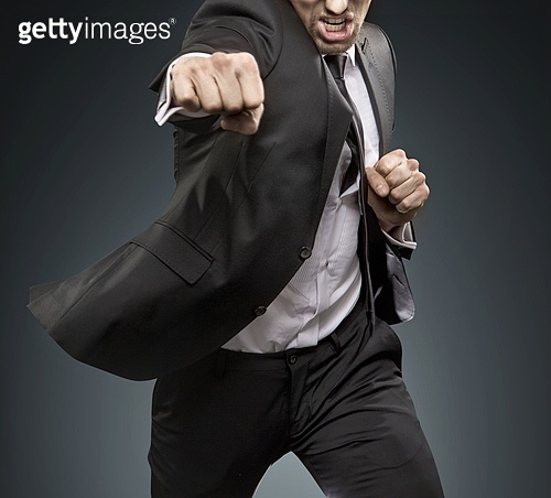 Brave businessman fighting againts challengers