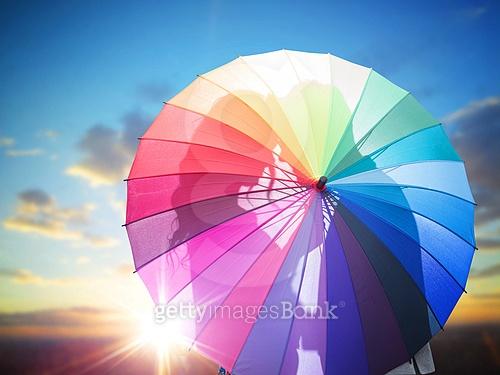Romantic couple kissing behind the umbrella