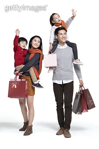 Happy young family shopping
