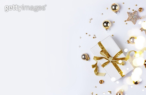 Christmas flat lay scene with git box with golden bow knot. Christmas flat lay scene with golden decorations