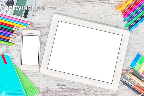 back to school hero header with school supplies on wooden table, copy space on blank screen of tablet and phone. back to school frame