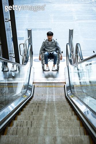 Escalator with a wheelchair