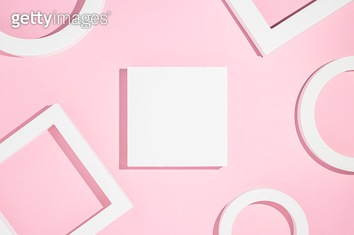 Geometric shapes on a pink background