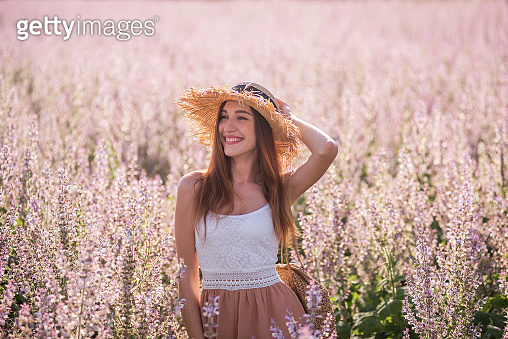 Young woman in blooming field