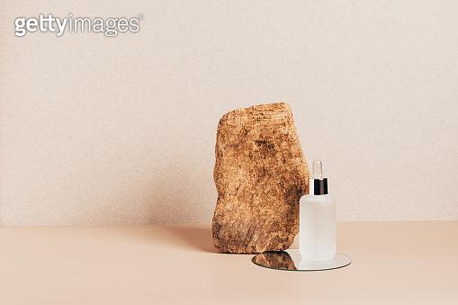 Cosmetics bottle on modern abstract podium