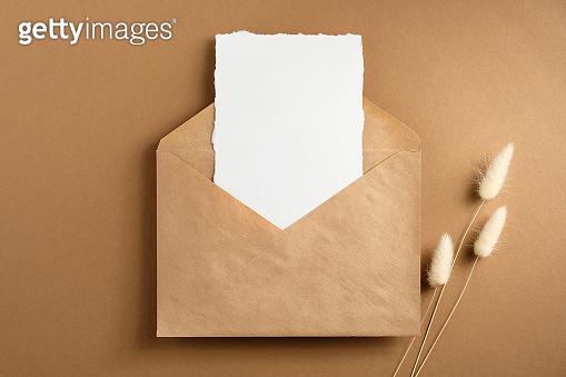 Envelope on brown background