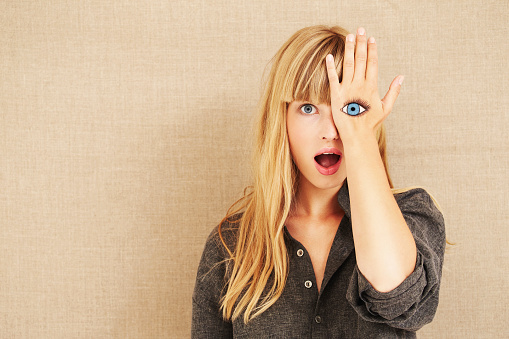 Shocked blond with painted eye