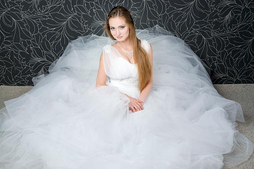 Beautiful bride, young woman in white wedding dress
