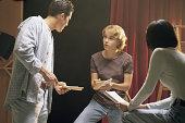 Teenage actors rehearsing play