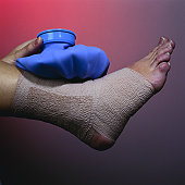 Elastic Support Bandage and Ice Pack on Ankle