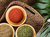 Spices in basket on table outdoors, overhead view