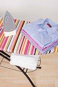Folded laundry on ironing board