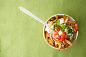 Bowl of french fries with toppings