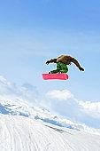 XL snowboarding big air