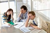 Frustrated businesspeople in meeting