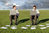 Two businessmen on Laptops