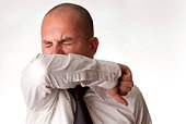 Man Coughing or Sneezing into Arm/Elbow