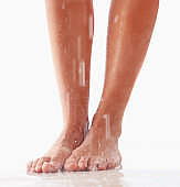 Closeup of nice wet legs on white