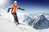 A person skiing down a dangerous icy slope