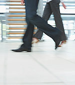 Low section motion image of business people walking