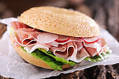 Bagel sandwich with proscuitto ham and radish