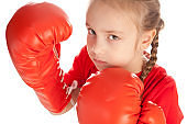 Attitude girl wearing red boxing gloves