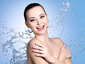 Happy woman in splashes of water