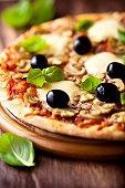 Pizza with mozzarella and mushrooms